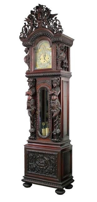 The top lot of the auction at $90,750 was this R.J.  Horner mahogany grandfather clock with J.J.  Elliott nine-tube works, heavily carved with winged griffins, pierced carved angel crest, flowers, foliage and birds.  It stands 118 1/2 inches tall.