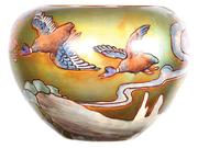 Marked Zsolnay art pottery jardiniere with an elaborate iridescent scene of ducks flying over trees and hills.
