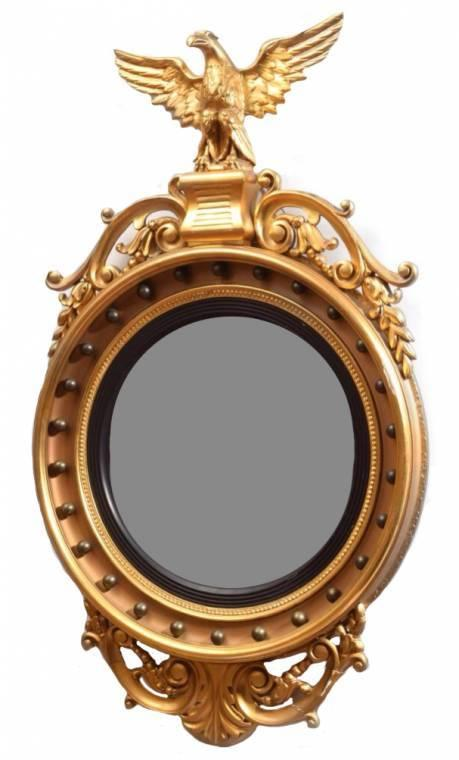 Monumental Federal 19th century American giltwood bull's eye mirror.