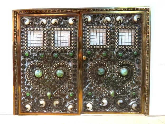 This gorgeous Moorish bronze jeweled fire screen, attributed to Tiffany Studios, sold for $60,000.