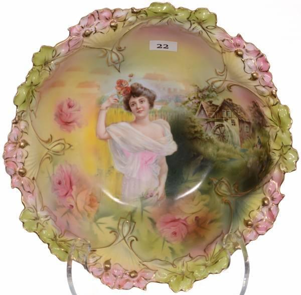 R.  S.  Prussia 10.5-inch mold #85 bowl having a pink, yellow and green background, with two rare scenes of a summer season portrait and mill scene decor.
