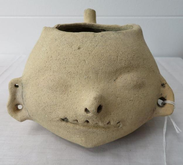 Prehistoric clay pot effigy of a human head, discovered in the Southeastern United States, 6.5 inches tall (est.  $1,000-$3,000).