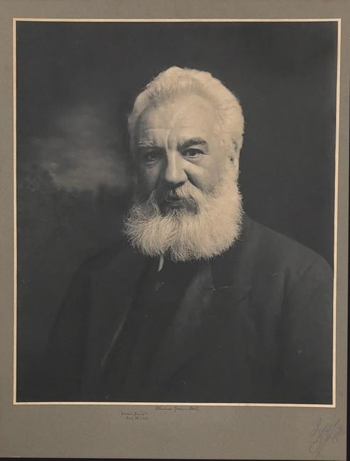 "Large photographic image of Alexander Graham Bell, on a mount of 32 inches by 24 inches, signed in fountain pen, ""Washington, D.C., May 18, 1921, Alexander Graham Bell."""