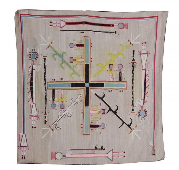 Spectacular Navajo pictorial weaving, a sand-painting example in the Whirling Log design, circa 1925 (est.  $18,000-$25,000).