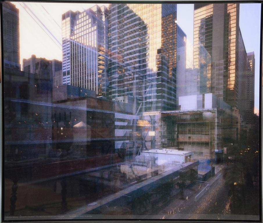 One of several Michael Wesely color print photos in steel frames, titled The Museum of Modern Art in New York City Under Construction, written by Wesely across the bottom.