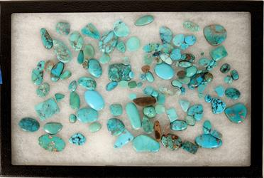 Wonderful lot of cut, polished turquoise from the American West, 100 pieces or more and totaling 170 grams, ranging in size from 2-25mm, mostly blue hues (est.  $3,000-$6,000).