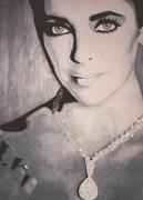 Artist proof lithograph of Liz Taylor by Sylvia Robert, mounted with crystals and signed and numbered (3/50) on verso (est.  $400-$600).
