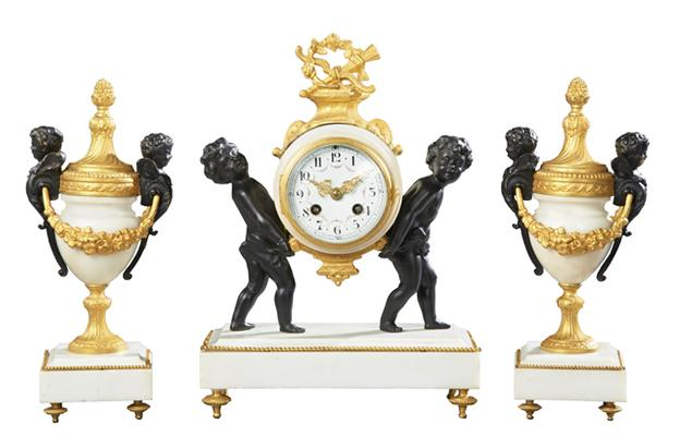 Early 20th century French gilt and patinated three-piece antique clock set by F.  Pelissier (est.  $500-$900).