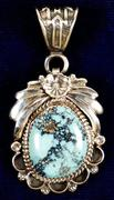 Gorgeous 18-karat lavender blue and turquoise stone set in a sterling silver pendant (est.  $1,000-$1,800).