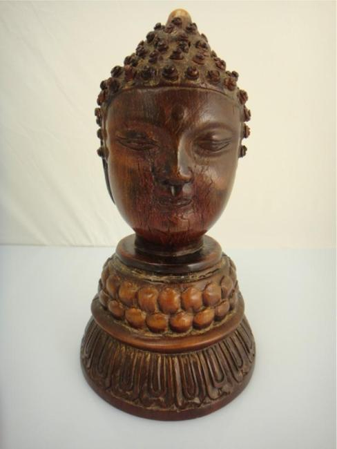 Lot 515: an 18th Century Chinese rhinoceros horn carved two-faced Buddha Head: $49,610