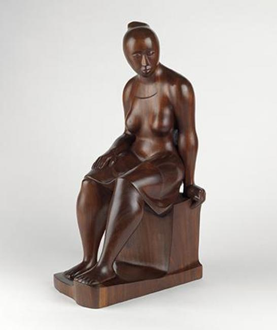 Elizabeth Catlett, Seated Woman, carved mahogany, 1962.  Estimate $100,000 to $150,000.