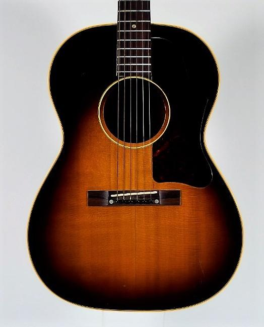 1957 Gibson LG-2 acoustic guitar with a sunburst finish over its spruce top and mahogany back and sides, in very good condition (est.  $2,000-$3,000).