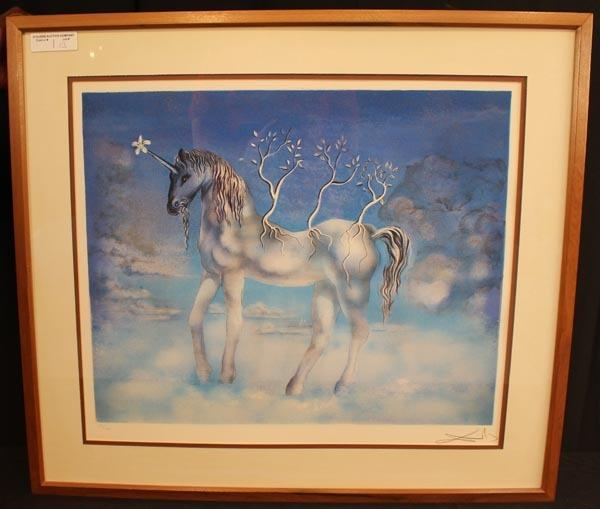 Lithograph signed and numbered by the renowned surrealist Salvador Dali, titled Blue Unicorn, 21 inches by 24 inches.