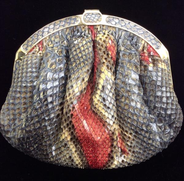 A snakeskin luxury handbag, marked for Florence Manelli, handmade in Italy, with detachable shoulder strap, will cross the block.