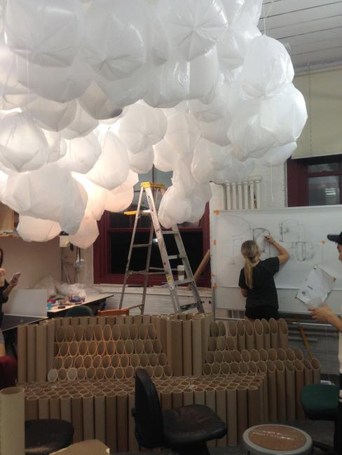 "A Pratt design student preparing ""Cloudspace,"" one of two visitor lounges for the METRO Show."