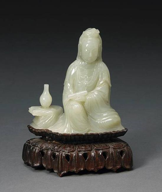 Lot No: 2090 A jade seated figure of Guanyin.  Estimate; $6,000-8,000.