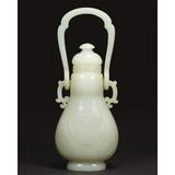 Chinese Pale Celadon Jade Covered Vase, 18th Century, Height overall 9 1/8 inches.  From the Estate of Baron Pierre DeMenasce.  Estimate $500,000-700,000.