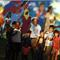 The Sioux Falls Arts Council in South Dakota used their NEA Our Town grant to revitalize the Whittier neighborhood of the city by bringing renowned muralist Dave Loewenstein (near center, wearing hat) to work with more than 250 community members to create The World Comes to Whittier, a 150-foot-long mural of the history and culture of the neighborhood.  Photo by Nicholas Ward, courtesy of Sioux Falls Arts Council.