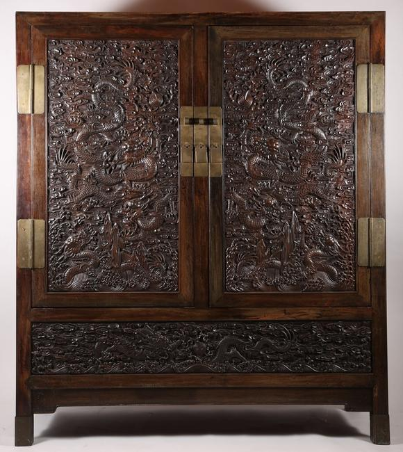 A Large Zitan Dragon Carved Cabinet, dating to the middle Qing period
