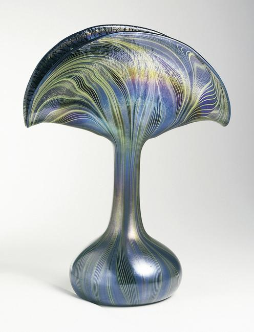 Peacock Vase Vase, ca.  1901; Produced by Tiffany and Co.  (United States); USA; mold-blown and iridized glass; H x W x D: 33.7 x 25 x 14 cm (13 1/4 x 9 13/16 x 5 1/2 in.); Gift of Stanley Siegel, from the Stanley Siegel Collection; 1975-32-11; Cooper Hewitt, Smithsonian Design Museum.