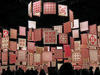 The American Folk Art Museum's installation of red and white quilts on view at New York's Park Avenue Armory through March 30.