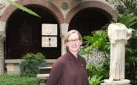 Dr.  Christina Nielsen, William and Lia Poorvu Curator of the Collection at the Isabella Stewart Gardner Museum in the Museum's Courtyard.