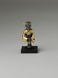 From Eskenazi, a Gold and Silver Standing Figure Warring States-Qin period, 4th-3rd century BC, height: 5.1 cm.