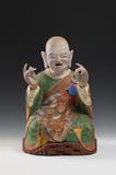 From Koo New York.  KOREAN: Rare Buddhist Polychrome Wood Figure of a Seated Nahan, Joseon Dynasty, 18th/19th century, original consecrated sutra pages remaining inside head cavity, the front carved with the identifier number &quot;two&quot; corresponding to Kanakavatsa (second disciple of historical Sakyamuni Buddha) Height 20 1/2 in.  (52 cm)