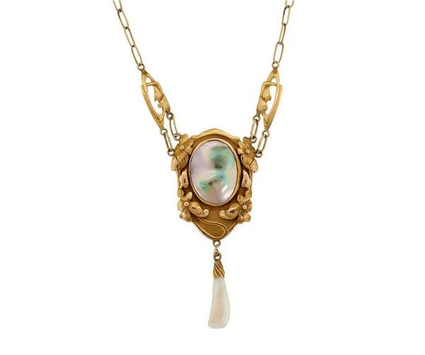 Kalo Shop pendant necklace of 14K yellow gold, blister pearl and dog tooth pearl, sold for $20,000 against an estimate of $5/7,000.