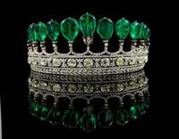 An emerald-and-diamond tiara brought a record price of $12.7 million.
