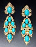This extravagant pair of turquoise and diamond earrings are mounted in gold and signed by Van Cleef & Arpels is offered by Epoque Fine Jewels..