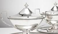 Pair of sterling silver sauce boats with stands and unusual squared handles, 1781.