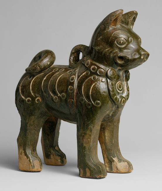 Figure of a dog, China, Eastern Han dynasty, 25–220 A.D.  Earthenware with dark green glaze.  Gift of Stanley Herzman, in memory of, in memory of Adele Herzman, 1991 (1991.253.1)