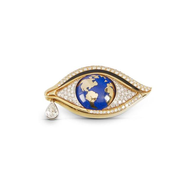 Mia Brattan 18kt, diamond, onyx, lapis lazuli eye-shaped brooch, with 100 round brilliant cut diamonds and one 1.03-carat pendeloque cut diamond (est.  CA$8,000-$12,000).