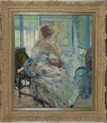 "Richard Edward Miller (American, 1875-1943), ""Woman at her Vanity with Earring,"" 1910-1914, oil on canvas"