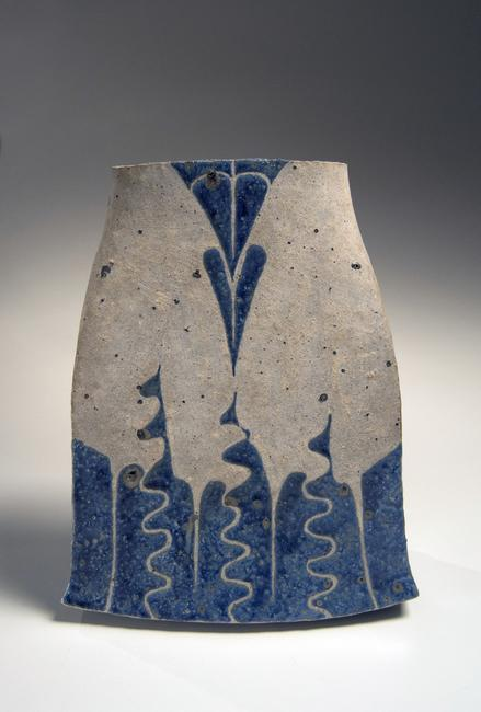 A white slip-glazed flattened vessel with flared base and mouth, with curvilinear decoration in blue overglaze enamel, by Kamoda Shōji (1933-1983)1976, Slip-glazed stoneware, 12 x 9 1/2 x 5 1/2 in.  Photography by Richard Goodbody.