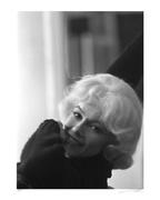 "This beautiful candid of Monroe was taken in 1960 behind the scenes of ""Let's Make Love"""