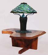 Tiffany Studios lily pad lamp on a George Nakashima low table