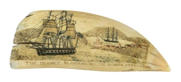 Scrimshaw whale's tooth by the Naval Monument Engraver sold for $396,00 at Eldred's Marine Sale.