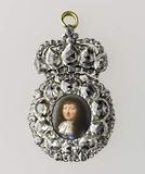 Presentation miniature of Louis XIV in a diamond-set frame, ca.  1670.  Workshop of Pierre and Laurent Le Tessier de Montarsy, goldsmiths; Jean Petitot I, enameler.  Miniature: painted enamel.  Mount: rose-cut and table-cut diamonds set in silver and enameled gold, 2 13/16 x 1 13/16 in.  (7.2 x 4.6 cm) Musée du Louvre, Département des Objets d'Art, Gift of the Société des Amis, 2009, OA 12280 © RMN-Grand Palais/Art Resource, NY/Jean-Gilles Berizzi