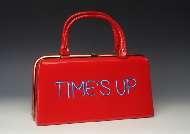 Michele Pred, Power of the Purse: Time's Up/ Equal Pay , 2018, vintage purse with electroluminescent wire, 11 x 12 x 4 inches