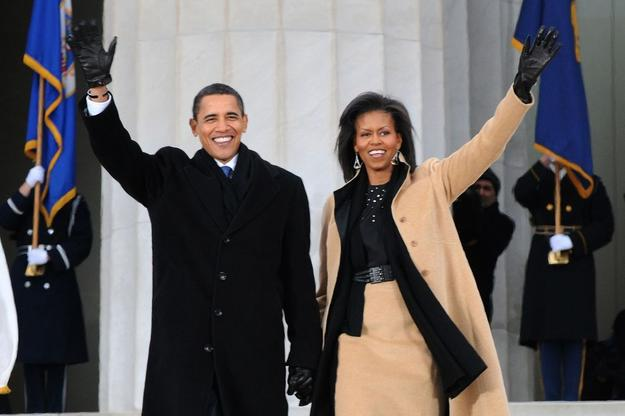 President-elect Barack Obama and Michelle Obama wave to the crowd gathered at the Lincoln Memorial on the National Mall in Washington, D.C., Jan.  18, 2009