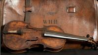 Wallace Hartley's violin played on the Titanic will be sold at auction.