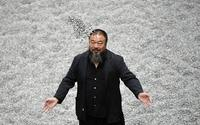 "Ai Weiwei at his exhibition ""Sunflower Seeds,"" a work consisting of 100 million hand-painted porcelain seeds, installed from Oct.  2010 to May 2011 at the Tate Modern in London."