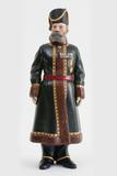 AN IMPORTANT FABERGÉ IMPERIAL RUSSIAN CARVED HARDSTONE PORTRAIT FIGURE OF KAMER-KAZAK N.N.  PUSTYNNIKOV, THE PERSONAL COSSACK BODYGUARD OF EMPRESS ALEXANDRA FEODOROVNA, ST.  PETERSBURG, DATED 1912.