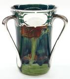 Clars Auction Gallery set a new world record on a Moorcroft for Shreve example by achieving $32,130.
