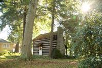 A 19th-century Ohio log cabin.  Estimate $4,000-6,000
