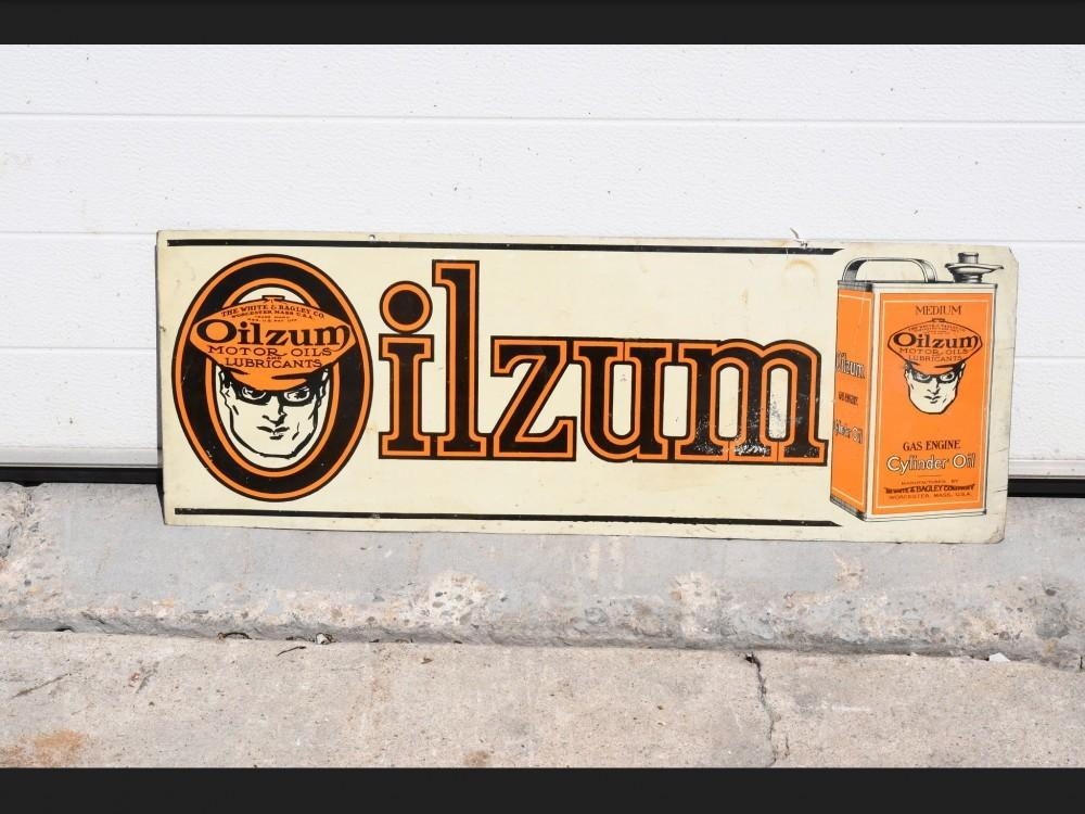Oilzum Cylinder Oil horizontal sign that has some flaws but has a great oil can graphic and measures 10 inches by 28 inches.