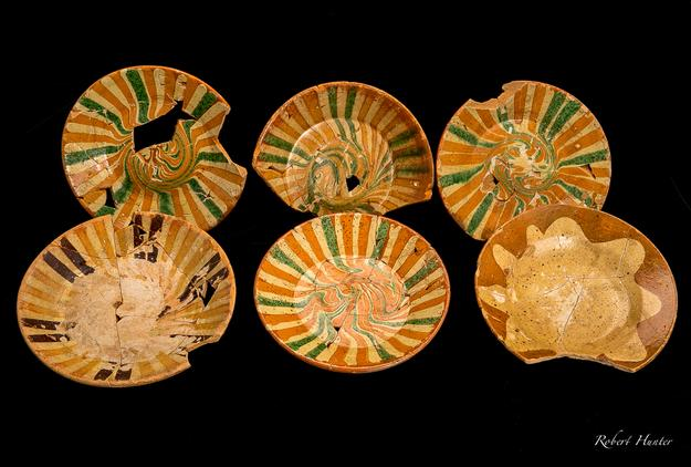 Decorative items from a remarkable assemblage of 18th-century slipware ceramics uncovered during an archaeological excavation in Philadelphia