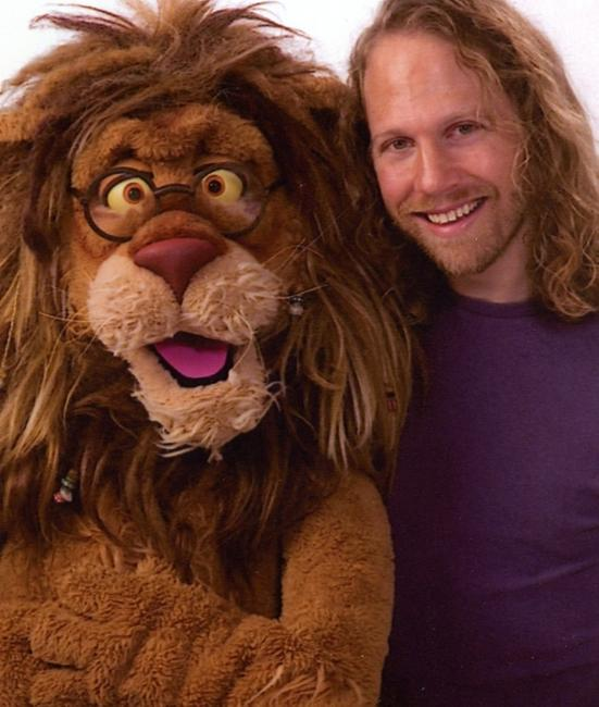 "Peter Linz & his character, Theo of PBS's ""Between the Lions"""